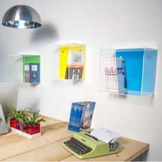 Idea for Custom Acrylic Displays:  Acrylic wall cube shelves with clear sides and colored acrylic back panel.