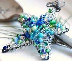 Wire Wrapped Star Beaded Ornament, Blue and Green Star, Suncatcher or Decoration - Blue Christmas. $21.50, via Etsy.
