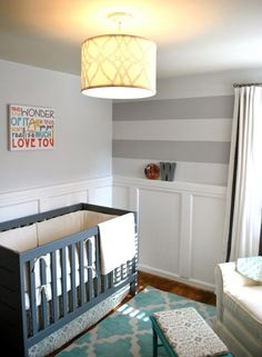 this room has almost everything I want in my baby room in it...board and batten, horizontal gray stripes...colored crib...and patterned rug (wrong colors though).