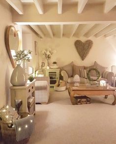 Lounge...greys..duckegg..taupe...country style ... wicker trunks. Extra large wicker heart ...