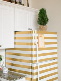 Washi tape is great, but it certainly isn't the only tape out there that can make a big impact in your home. It only took Dina from Honey & Fitz two rolls of gold duct tape to turn a basic white fridge into a glitzy showstopper.