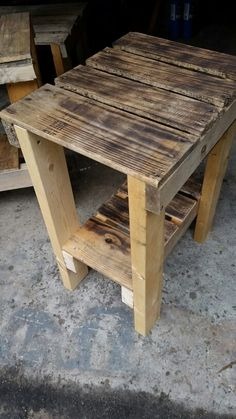 End table made out of pallets, used a torch to give it the blackness.