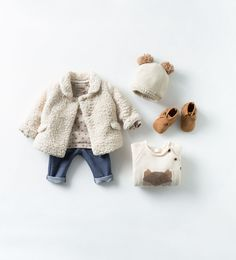 SHEARLING THREE-QUARTER LENGTH COAT  STAR MOTIF SWEATSHIRT  DENIM LEGGINGS  LEATHER FRINGED BOOTS
