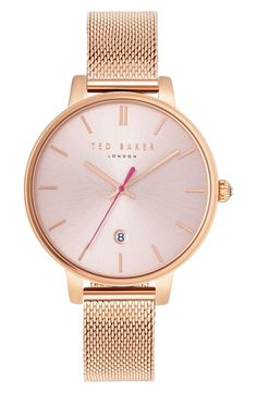 This sleek and sophisticated rose gold watch precisely ticks three-hand time.