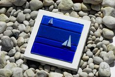 These fused glass wall panels are available in Blue (shown here) & Aqua, and are mounted ready to hang from a fitted brass plate hook