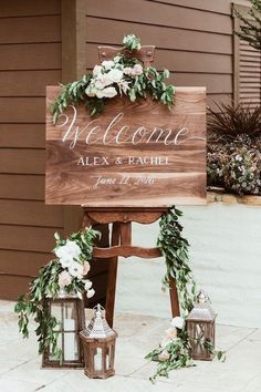 Industrial meets vintage on this ultra romantic welcome wedding sign. Lanterns, flowers and greenery do the trick. #weddingsigns #woodensign #planning