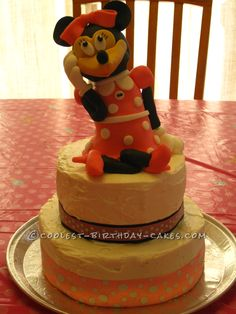 Coolest Minnie Mouse Birthday Cake... This website is the Pinterest of birthday cake ideas