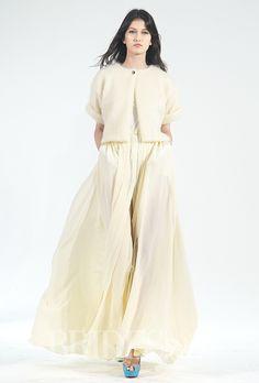 Brides.com: . Trend: Outerwear. Three quarter sleeve open front mohair cardigan over a short sleeve silk jersey t-shirt with an A-line floor-length silk skirt, Houghton