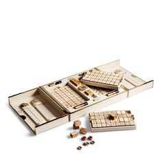 Inspired by the modern glamour of penthouse living, our luxurious mahjong set was custom-designed with hand-painted leather tiles, each inset into cherry wood. The accompanying leather-and-brass box opens to reveal a built-in game board as well as matching push sticks, a set of dice, and betting coins for the ultimate way to play the ancient Chinese pastime.
