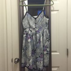 UO [Reformed] Lacey flower Dress. SIZE M UO [Reformed] Lacey flower Dress. SIZE M. Blue and purple flower dress with black lace trim. Buttons all the way up and fits true to size! There is a criss cross tie on the back for adjustments. Adjustable straps as well. Worn only one time. In great condition! Urban Outfitters Dresses Mini