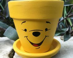 Pooh Bear Hand Painted Flower Pot Winnie the Pooh inspired hand painted 4 inch terra cotta pot with Flower Pot Art, Flower Pot Design, Clay Flower Pots, Flower Pot Crafts, Clay Pots, Cactus Flower, Flower Bookey, Flower Film, Flower Band