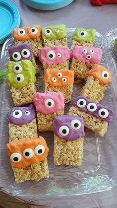 Monster Rice Krispies Treats. A little melting chocolate in different colors, and some edible candy eyes. Great for a Halloween class party.