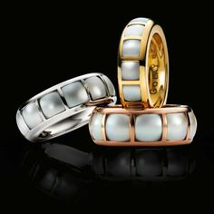 Louis Golay rings with cut pearls fit into squares.