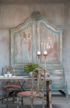 "Wonderful, massive aged blue cupboard with antique chairs also well aged and a bit ""rough."""