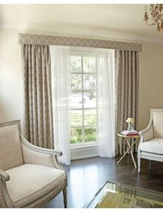 Three tiers ~ voile for privacy and diffusing sunlight, simple pencil pleat curtains finished with a narrow pelmet to keep the whole window light and airy