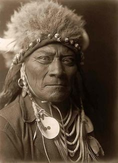 An Indian Warrior Wearing a Buffalo Head Dress.  Here is a photograph of One Blue Bead, an Old Indian Warrior. It was created in 1908 by Edward S. Curtis.