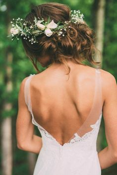 Backless bridal gown and lush floral crown of white | Photography by The Image Is Found