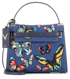 Valentino - My Rockstud appliqué denim shoulder bag - We love the fresh, colourful update to Valentino's My Rockstud shoulder bag. The denim upper is made cheerful with all-over butterfly appliqué in an engaging array of hues. We adore this vibrant piece worn as part of a nonchalant-chic look at the weekend or with a sleek pencil skirt to the office. seen @ www.mytheresa.com