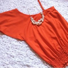 Never worn. Gorgeous orange shirt. Strap is adjustable. New. Never worn. Bought it new with not tags. Gianni Bini Tops Blouses