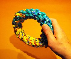 Create this two-tone ring dog toy by combining two lengths of the basic 4 strand crown knot.
