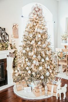 Silver & Gold Christmas Tree How to decorate a beautiful, classic silver and gold Christmas tree Flocked Christmas Trees Decorated, Elegant Christmas Trees, Silver Christmas Decorations, Cool Christmas Trees, Christmas Tree Themes, Beautiful Christmas, Simple Christmas, Christmas Christmas, Christmas Lights