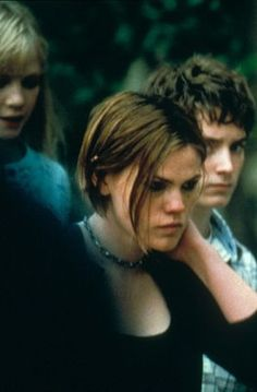 Clea DuVall as Stokely 'Stokes' Mitchell & Elijah Wood as Casey Connor - The Faculty
