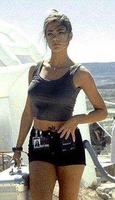 Denise richards as Dr Christmas jones nuclear physicist in the world isnot enough