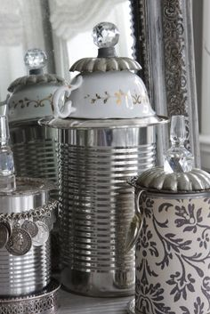 Charming...canisters made from tin cans, teacups, decanter stoppers & other bits & pieces