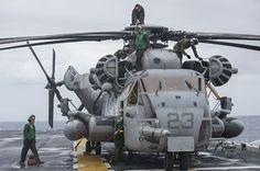 Marines conduct a preflight check of a CH-53E helicopter on the flight deck of amphibious assault ship USS Bonhomme Richard (LHD 6).