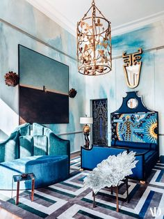 Paris decorator Vincent Darré's bedroom features a Marc Bankowsky pendant and a Darré-design carpet.