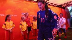 Homare Sawa #10 of Japan enters the pitch