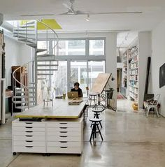 Another great workspace with huge windows and a spiral staircase. I think I might need to invest in some of those Ikea Alex drawers...