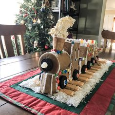 What happens when an art and architecture lover has two boys who are little gear-heads? They veto her gingerbread house for Christmas and demand a gingerbread train. This really ended up being a fu… Gingerbread Train, Gingerbread Village, Christmas Gingerbread, Christmas Cookies, Christmas Desserts, Christmas Train, Christmas Home, Christmas Holidays, Xmas
