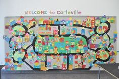 """Collage Paper Shape Houses made into """"Carleville"""" paper city, for A Place to Call Home Project   The Eric Carle Museum's Art Studio Blog #activities #kids #classroom"""