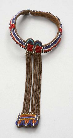 Africa | Arm band from the Kipsigis people of the Rift Valley Province, Kenya | Goat skin, plant fiber, glass beads and metal | ca. 1960/70s