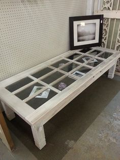glass door coffee table - imagine my kids old stuffed animals, favorite toys or movies they loved, or old photos...memories in a box