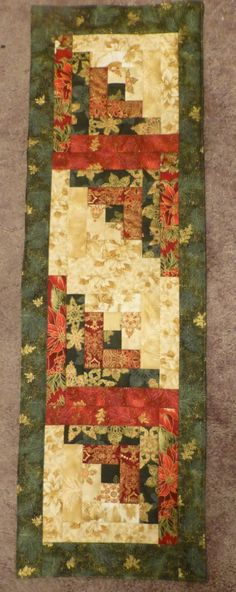 This Quilted Table Runner is an Exquisite Red, Green, Gold and Off-white Log Cabin Pattern and the other side is adorned with Gorgeous Pointsettias from Robert Kaufman's Holiday Flourish Collection. Table Topper Patterns, Table Toppers, Table Runner And Placemats, Quilted Table Runners, Christmas Sewing, Christmas Holiday, Quilted Gifts, Japanese Quilts, Fall Quilts