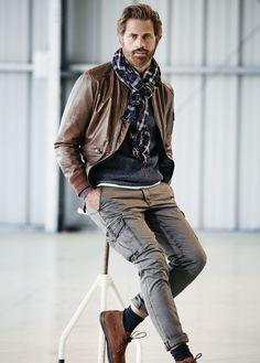 Shop this look on Lookastic:  https://lookastic.com/men/looks/bomber-jacket-crew-neck-sweater-cargo-pants/14419  — Navy Plaid Scarf  — Navy Crew-neck Sweater  — Brown Leather Bomber Jacket  — Grey Cargo Pants  — Navy Socks  — Brown Suede Desert Boots