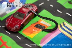 """Beep, beep! Part of the """"town car mat series"""", this car play mat allows your child to take the fun of playing with cars and trains on-the-go."""
