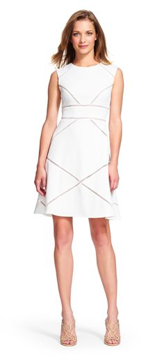 Adrianna Papell textured fit and flare dress with sheer insets   Sheer mesh criss-crosses in a geometric fashion on this textured day dress. This jacquard dress is intermixed with mesh that shows off the nude lining for a modest yet sultry style. The fit and flare dress is super flattering featuring a sleeveless bodice makes this makes it perfect for warm summer days. A back zip closure finishes off this dress.