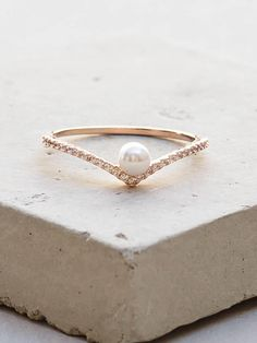 V Pearl Ring - Rose Gold from The Faint Hearted. Shop more products from The Faint Hearted on Wanelo.