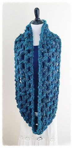 THE NEBULA INFINITY SCARF Materials: ~ Lion Brand Homespun Thick & Quick, 2 skeins of thesame color ~ 19 mm crochet hook Instructions: Work entire scarf with 2 strands of yarn. Chain 60, join …