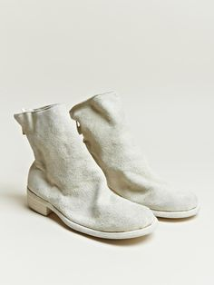 Maison Martin Margiela suede boots in cream.