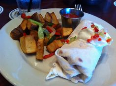 Duck breakfast burrito at South of Beale. Great food, Memphis gastropub. Ghost River on draft.