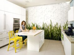 textured wall + yellow pops in founder of sprinkles cupcakes' home kitchen.