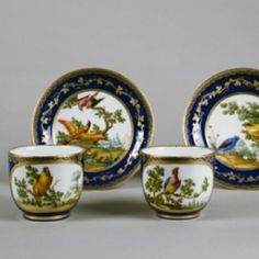 Tableware: A Fine Pair of Sèvres Cups & SaucersA Fine Pair of Sèvres Cups & Saucers thumbnailA Fine Pair of Sèvres Cups & Saucers thumbnailA Fine Pair of Sèvres Cups & Saucers thumbnail A Fine Pair of Sèvres Cups & Saucers, 1773 These gobelets Bouillard et soucoupes are decorated with a bleu nouveau ground and very finely painted birds in landscapes by Louis-Denis Armand - the best bird painter at the Sèvres factory. They have factory marks and the date letter T for 1773.