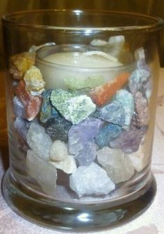 To charge a candle, place gemstones or gemstone chips inside another candle holder with the candle.