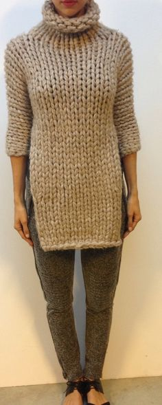 """Lush chunky wool knit from Jbrand rtw. Great on trend piece to brighten up you remaining winter days.  Rolled mock turtleneck, 3/4 sleeves, open side panels giving this piece an ultra chic look. Perfect with some leather leggings. Size: 32"""" length 34"""" bust Original Retail approximately $700"""