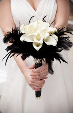 instead of black feathers-Framing my bouquet with pheasant feathers. No lillies