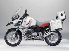 BMW gs, the huge tank is for crossing places like Mongolia, Sahel or the salt flats of the Bolivian altiplano, 9.5 gallons.